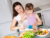 Mother and daughter eat bread Royalty Free Stock Image
