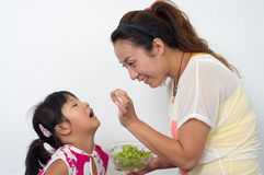 Mother daughter eat fruit Stock Image