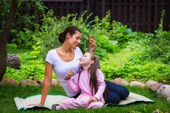 Mother and daughter eat ice-cream Royalty Free Stock Photo