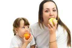 Mother and daughter eating apples Royalty Free Stock Photography