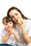 Mother and daughter eating apples Royalty Free Stock Photo