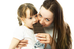 Mother and daughter eating chocolate Stock Images