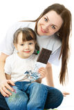 Mother and daughter eating chocolate Stock Image