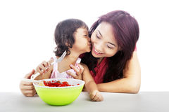 Mother and Daughter eating fruit salad Royalty Free Stock Photo