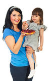 Mother with daughter eating fruit tart Royalty Free Stock Images