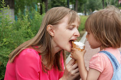 Mother and daughter are eating icecream Royalty Free Stock Photo