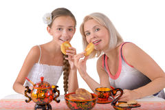Mother and daughter eating pies Royalty Free Stock Images