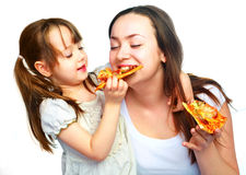 Mother and daughter eating pizza royalty free stock photos