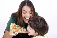 Mother and daughter eating pizza slice Royalty Free Stock Photos