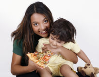 Mother and daughter eating pizza slice Royalty Free Stock Image