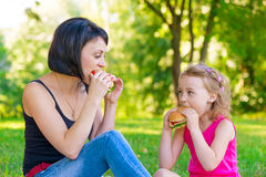 Mother and daughter eating sandwiches at a picnic Stock Photography