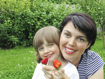 Mother and daughter eating strawberries Stock Photo