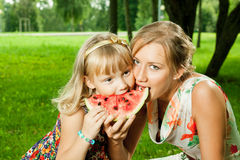 Mother and daughter eating watermelon Royalty Free Stock Photos