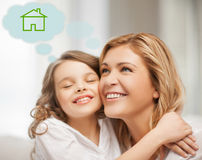 Mother and daughter with eco house. Home, real estate and family concept - mother and daughter with eco house Stock Photos