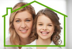 Mother and daughter with eco house Royalty Free Stock Image
