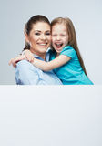 Mother and daughter embrace. Business woman with k Stock Photography