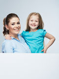 Mother and daughter embrace. Business woman with kid girl. Iso Royalty Free Stock Photography