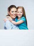 Mother and daughter embrace. Business woman with kid girl. Iso Stock Photos