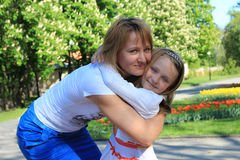 Mother and daughter embrace Stock Photos