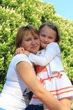Mother and daughter embrace Stock Photo