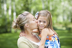 A mother and daughter embracing Stock Images