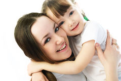Mother and daughter embracing Stock Images