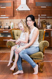 Mother and daughter embracing indoors. At home Stock Photo
