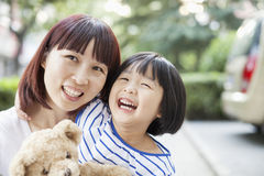 Mother and Daughter Embracing and Laughing Stock Image