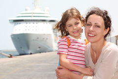 Mother and daughter embracing, looking at camera Stock Photography