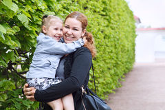 Mother and daughter embracing together Stock Image