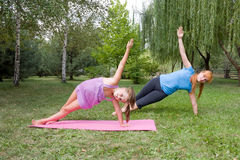 Mother and daughter engage in fitness Royalty Free Stock Photo
