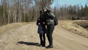 Mother and daughter enjoy early spring days stock video footage