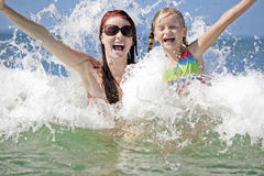 Mother and daughter enjoy hot summer day. Stock Image