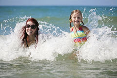 Mother and daughter enjoy hot summer day. Stock Photo