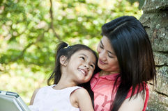 Mother and daughter enjoy their tablet PC. Royalty Free Stock Photos