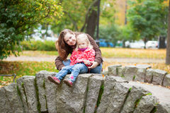 Mother and daughter enjoying autumn day Royalty Free Stock Photography