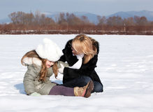 Mother and  daughter enjoying beautiful winter day Stock Images