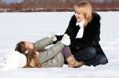 Mother and  daughter enjoying beautiful winter day Royalty Free Stock Photos