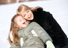 Mother and daughter enjoying beautiful winter day Stock Photography
