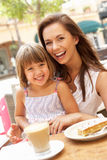 Mother And Daughter Enjoying Cup Of Coffee Royalty Free Stock Image