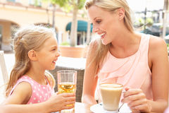 Mother And Daughter Enjoying Cup Of Coffee Royalty Free Stock Photography