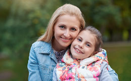 Mother and daughter enjoying the day outdoors Royalty Free Stock Images