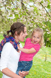 Mother and Daughter enjoying a funny moment while taking a walk Royalty Free Stock Photo