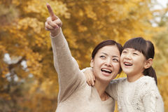 Mother and Daughter Enjoying a Park in Autumn Stock Photo