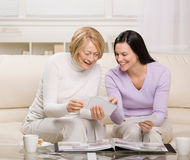 Mother and daughter enjoying photo album Stock Photo