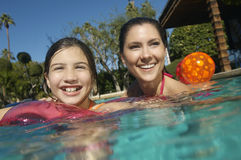 Mother And Daughter Enjoying In Pool Stock Images