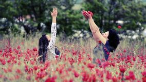 Mother and daughter enjoying in poppy field, vintage stock footage