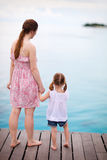 Mother and daughter enjoying sea views Stock Photos