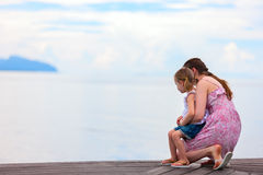 Mother and daughter enjoying sea views Royalty Free Stock Images