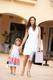 Mother And Daughter Enjoying Shopping Trip Stock Image